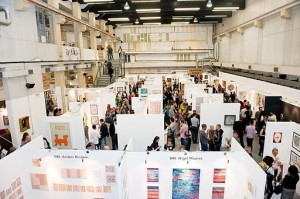 View of a busy art fair, from Wikimedia Commons, copyright Fiona E. Campbell
